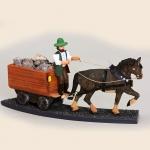 Bergmann in der Förderung mit Pferdewagen