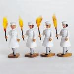 4 Bäckergesellen mit Fackel